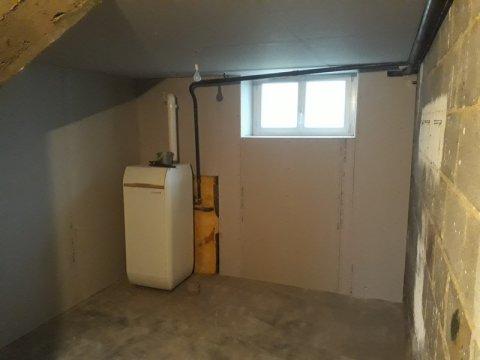 Isolation d'un garage sous plancher de la partie habitable et doublage des murs extérieurs sur Riom